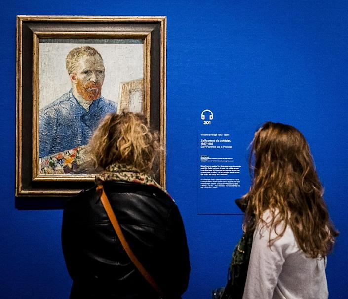 Visitors looking at a painting by Vincent Van Gogh at the Van Gogh Museum in Amsterdam (AFP Photo/Remko de Waal)