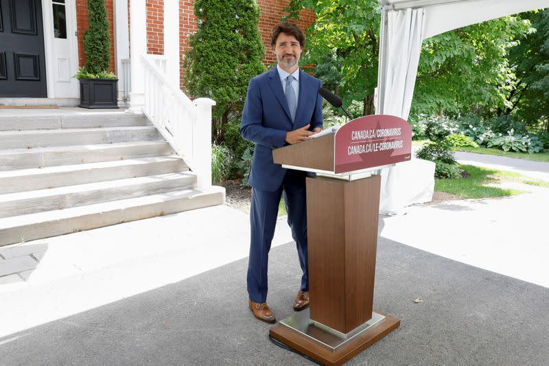 Canada's Prime Minister Justin Trudeau leaves a news conference in Ottawa