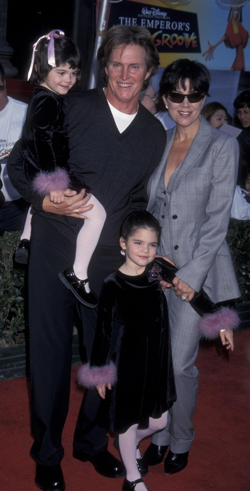 Kylie Jenner, Caitlyn Jenner (formerly Bruce Jenner), Kendall Jenner, and Kris Jenner at the world premiere of The Emperor's New Groove in Hollywood, California, December 2000.