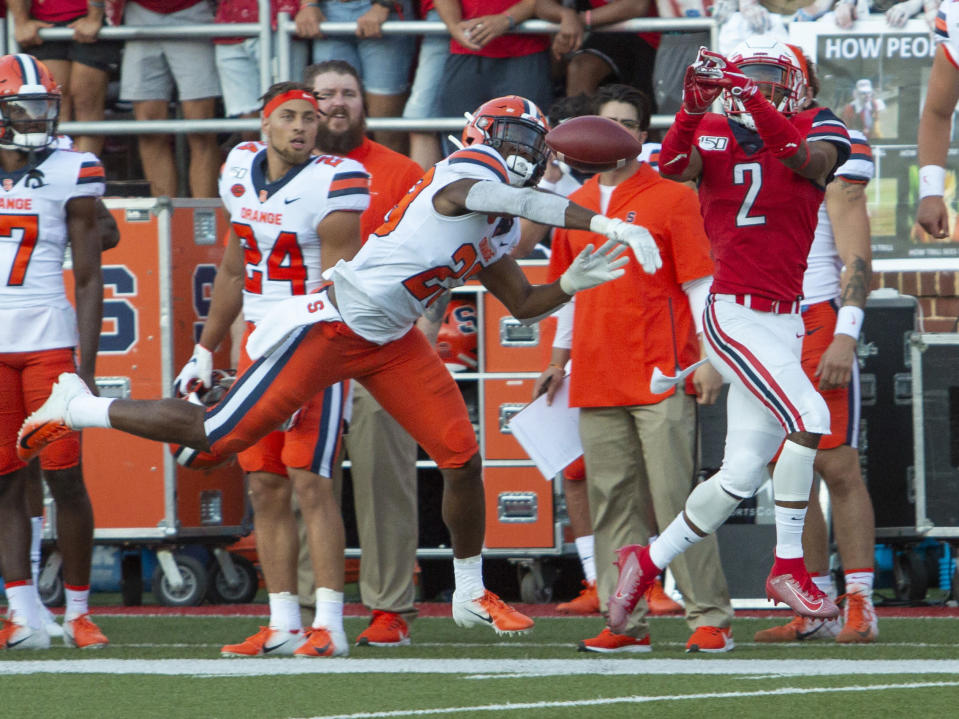 Syracuse's Adrian Cole bats away a pass intended for Liberty wide receiver Kevin Shaa during an NCAA college football game in Lynchburg, Va. Saturday, Aug. 31, 2019. (AP Photo/Matt Bell)