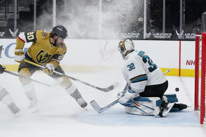 San Jose Sharks goaltender Josef Korenar (32) blocks a shot by Vegas Golden Knights center Chandler Stephenson (20) during the second period of an NHL hockey game Wednesday, April 21, 2021, in Las Vegas. (AP Photo/John Locher)