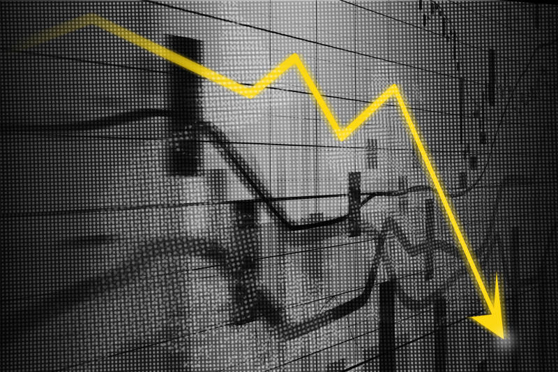 Stock market charts in grey with a yellow arrow line indicating losses.