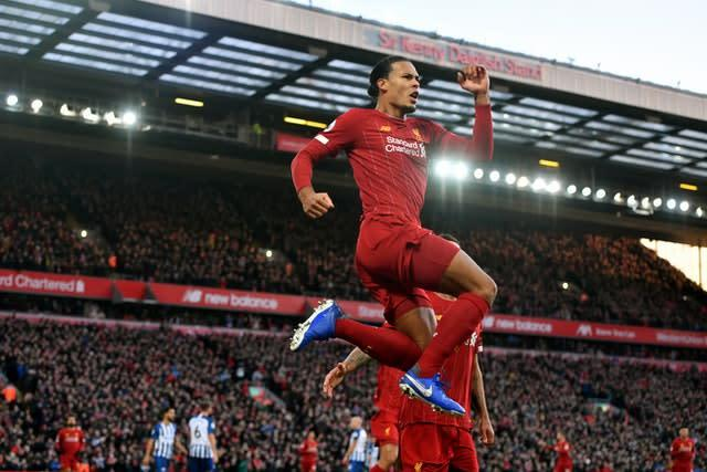 Virgil van Dijk was the unlikely goalscoring hero when Liverpool scraped past Brighton at Anfield. The Holland defender headed two first-half goals before the hosts were forced to hang on for a 2-1 victory following the dismissal of goalkeeper Alisson Becker (Anthony Devlin/PA)