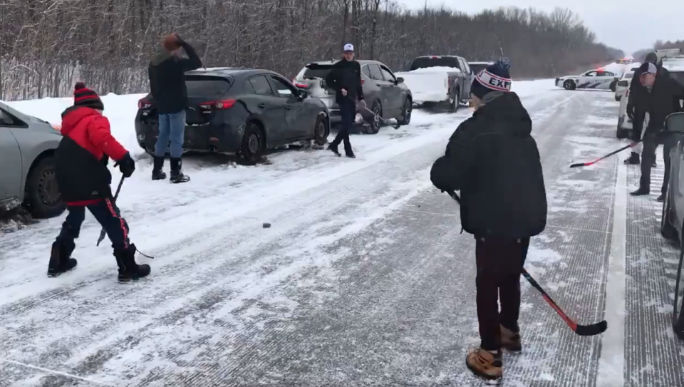 A massive pileup on an icy highway northeast of Montreal yielded an impromptu game of puck on Sunday. (Twitter/Steverukavina)