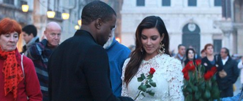 Kanye handing Kim a red rose