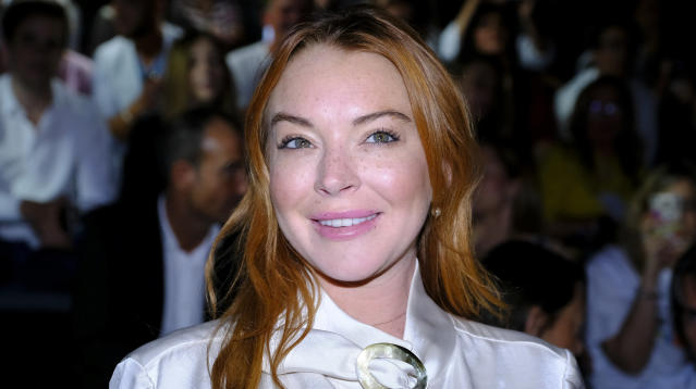 Actress Lindsay Lohan came to Harvey Weinstein's defense on Wednesday and issued a stern message to the film producer's wife, fashion designer Georgina Chapman.