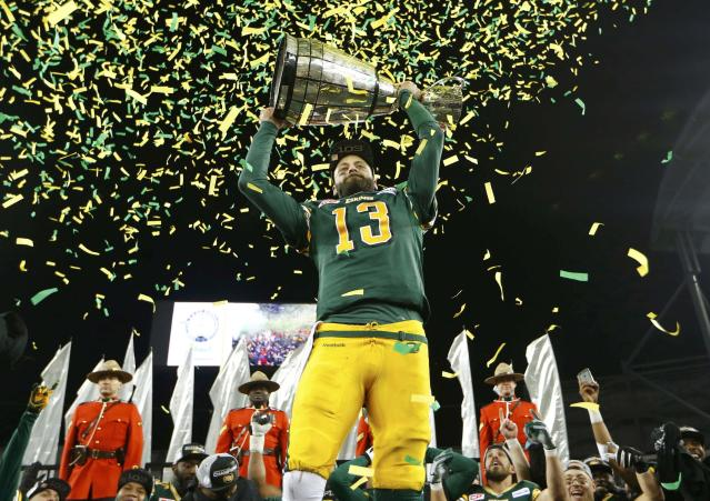 Edmonton Eskimos quarterback Mike Reilly raises the Grey Cup after his team defeated the Ottawa Redblacks in the CFL's 103rd Grey Cup championship football game in Winnipeg, Manitoba, November 29, 2015. REUTERS/Lyle Stafford