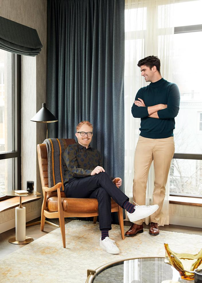 "<div class=""caption""> Ferguson (seated) and Mikita pose in their living room. The leather chair is from their previous apartment and was purchased at <a href=""http://www.abchome.com/"" rel=""nofollow noopener"" target=""_blank"" data-ylk=""slk:ABC Carpet & Home"" class=""link rapid-noclick-resp"">ABC Carpet & Home</a>. </div>"