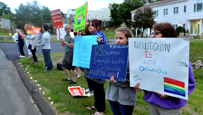 Nearly two dozen protesters showed up in front of the National Shooting Sports Foundation in Newtown, Conn., for a candlelight vigil to remember the victims of the Orlando mass shooting, which took place June 12, 2016. (Photo: Peter Casolino/Hartford Courant/TNS via Getty Images)
