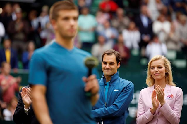 Tennis - ATP - Halle Open Finals - Gerry Weber Stadion, Halle, Germany - June 24, 2018 Switzerland's Roger Federer watches on alongside Czech model and actress Eva Herzigova after losing the final against Croatia's Borna Coric REUTERS/Leon Kuegeler