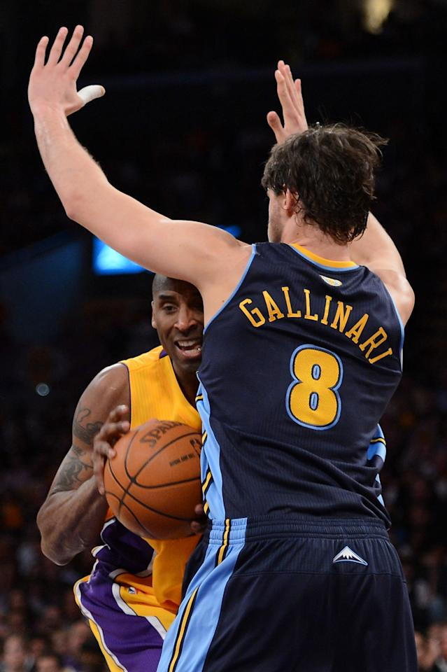 LOS ANGELES, CA - MAY 12:  Kobe Bryant #24 of the Los Angeles Lakers drives into Danilo Gallinari #8 of the Denver Nuggets in the first half in Game Seven of the Western Conference Quarterfinals in the 2012 NBA Playoffs on May 12, 2012 at Staples Center in Los Angeles, California. NOTE TO USER: User expressly acknowledges and agrees that, by downloading and or using this photograph, User is consenting to the terms and conditions of the Getty Images License Agreement.  (Photo by Harry How/Getty Images)