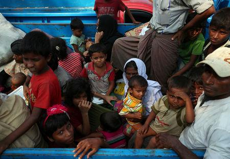 Rohingya refugees who arrived from Myanmar wait on a truck that will take them to a refugee camp from a relief centre in Teknaf