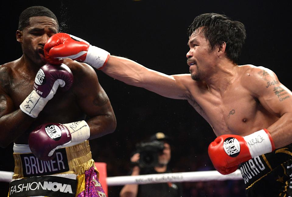 Manny Pacquiao lands a punch vs. Adrien Broner in their WBA welterweight title match at MGM Grand Garden Arena. Pacquiao won via unanimous decision. (USA Today Sports)