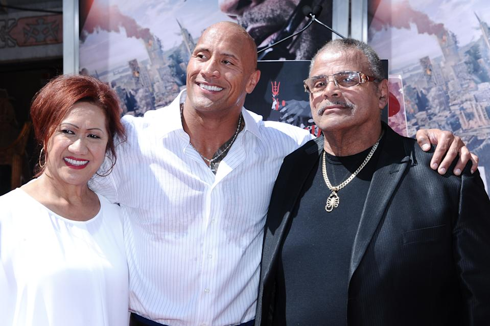 Dwayne Johnson with parents Ata Johnson and Rocky Johnson at his hand and footprint ceremony held at the TCL Chinese Theatre on Tuesday, May 19, 2015. (Photo by Richard Shotwell/Invision/AP)