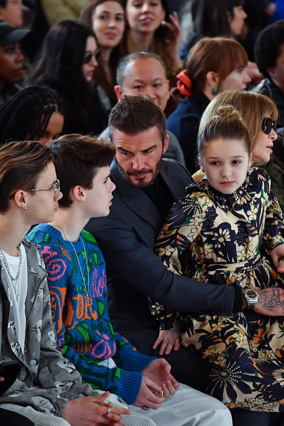 David Beckham sat with his three youngest children beside Anna Wintour [Image: Getty]