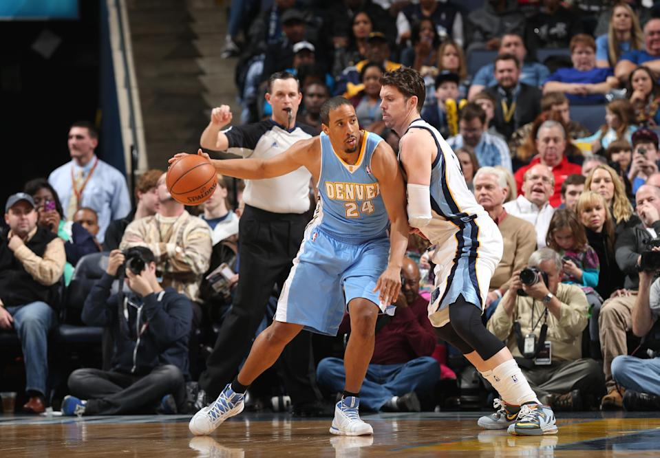 MEMPHIS, TN - DECEMBER 28: Andre Miller #24 of the Denver Nuggets controls the ball against Mike Miller #13 of the Memphis Grizzlies on December 28, 2013 at FedExForum in Memphis, Tennessee. (Photo by Joe Murphy/NBAE via Getty Images)
