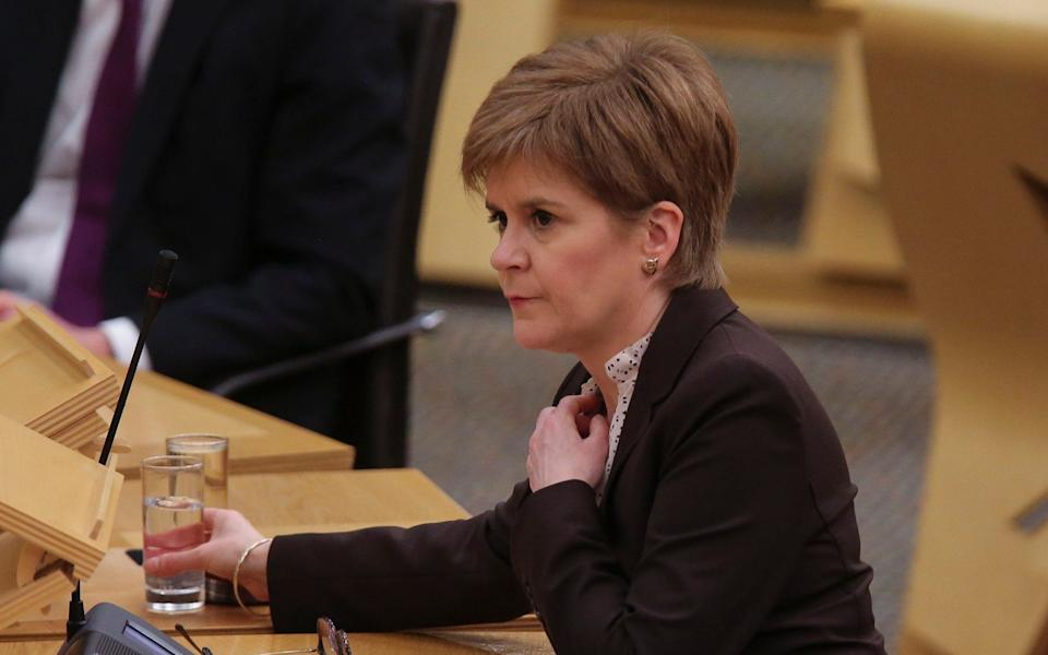 Nicola Sturgeon updates MSPs on any changes to the Covid-19 restrictions in Scotland - Pool/Getty