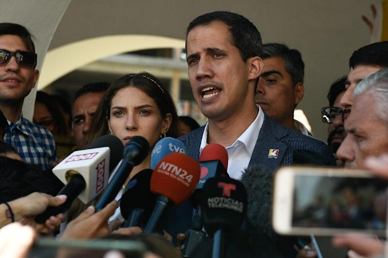 Juan Guaido, Venezuela's National Assembly leader and self-proclaimed acting president, is in a test of wills with President Nicolas Maduro (AFP Photo/Federico PARRA)