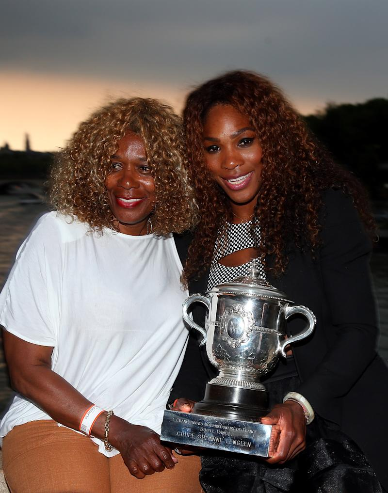 PARIS, FRANCE - JUNE 08: Serena Williams of USA and mother, Oracene Price pose with the Coupe Suzanne Lenglen trophy in front of the Eiffel Tower after her win over Maria Sharapova of Russia in the Women's Singles final during Day Fourteen at Roland Garros on June 8, 2013 in Paris, France. (Photo by Julian Finney/Getty Images) (Getty Images)