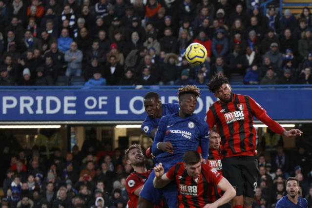 Bournemouth's Simon Francis, right, jumps for the ball with Chelsea's Tammy Abraham, second right, during the English Premier League soccer match between Chelsea and Bournemouth, at Stamford Bridge in London, Saturday, Dec. 14, 2019. (AP Photo/Ian Walton)