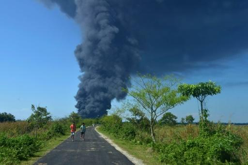 The explosion sent bright orange flames and huge, black plumes of smoke�high into the sky in India's Assam state