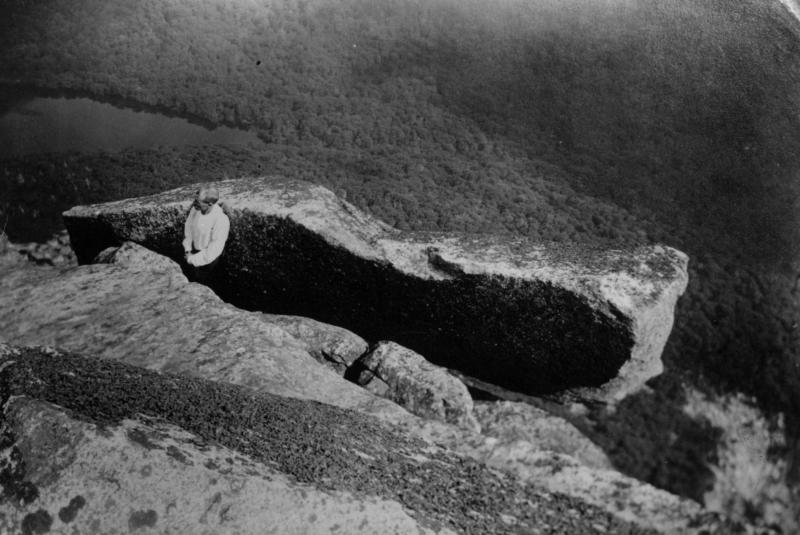 In this photo provided by the Littleton Area Historical Society, Edward Geddes examines what was the top of the Old Man of the Mountain profile in this early 1900s photo in Franconia, N.H. Geddes, a stone quarry superintendent from Quincy, Mass., was the first man to do repair work on New Hampshire's iconic figure, which fell nearly ten years ago. (AP Photo/Littleton Area Historical Society, Rev. Guy Roberts)