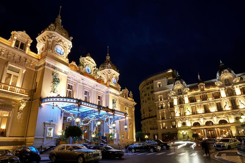 Facade of 'Monte Carlo casino' gambling and entertainment complex illumimated at night opened in 1863. Image: Getty