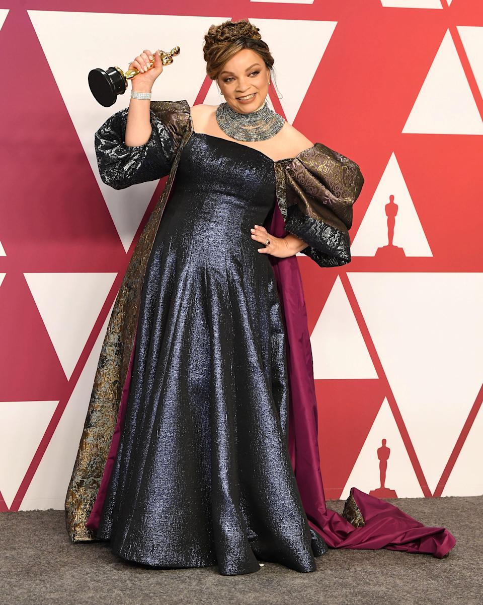 Ruth E. Carter made history with her costume work in 2019's <em>Black Panther,</em> when she became the first Black woman to win the Oscar for costume design. Carter designed the film's many Afrofuturist looks, and while her own red carpet look leaned more into traditional Hollywood glamour, it still nodded to the distinctive aesthetic of her movie. Her brocade sleeves and train channeled the film's royal characters, while her choker-style necklace was reminiscent of the armor worn by many of Wakanda's warriors.