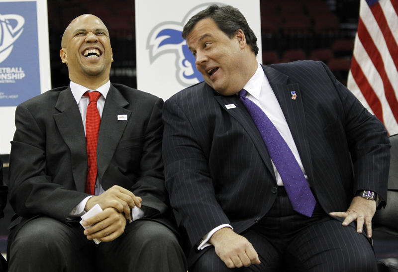 FILE - In this Jan. 25, 2011 file photo, Newark Mayor Cory Booker, left, jokes with New Jersey Governor Chris Christie during a news conference at the Prudential Center in Newark, N.J. Christie and Booker are channeling the Seinfeld-Newman rivalry in a video parody that spoofs the mayor's heroics and Christie's vice presidential potential. The video played Tuesday, May 15, 2012 at the New Jersey Press Association's Legislative Correspondents Club show. (AP Photo/Julio Cortez, File)