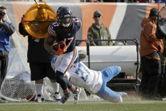 Chicago Bears wide receiver Anthony Miller (17) breaks away from Detroit Lions free safety Glover Quin (27) for a touchdown during the first half of an NFL football game Sunday, Nov. 11, 2018, in Chicago. (AP Photo/Nam Y. Huh)