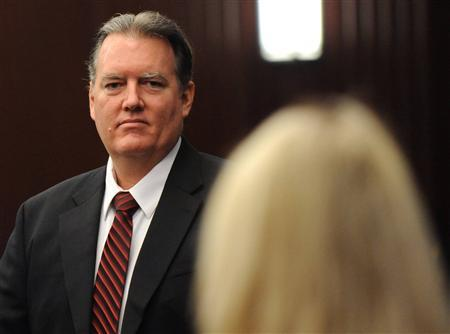 Michael Dunn looks at his family during a morning recess at his murder trial in the shooting death of unarmed teen Jordan Davis, in Duval County Courthouse in Jacksonville, Florida on February 10, 2014. Dunn is accused of first degree murder in death of Davis after an altercation over loud rap music at a Florida gas station in November 2012. REUTERS/Bob Mack/Pool
