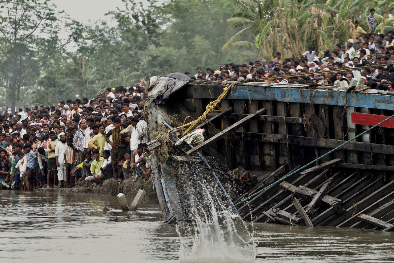Rescuers pull out the wreckage of a ferry that capsized in the Brahmaputra River at Buraburi village, about 350 kilometers (215 miles) west of the state capital Gauhati, India, Tuesday, May 1, 2012. Army divers and rescue workers pulled more than 100 bodies out of a river after a packed ferry capsized in heavy winds and rain in remote northeast India, an official said Tuesday. At least 100 people were still missing Tuesday after the ferry carrying about 350 people broke into two pieces late Monday, said Pritam Saikia, the district magistrate of Goalpara district. (AP Photo/Anupam Nath)