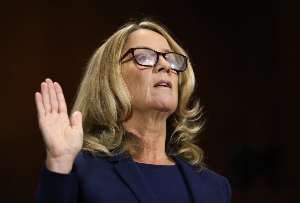 Christine Blasey Ford is sworn in before the Senate Judiciary Committee, Sept. 27, 2018, on Capitol Hill in Washington. (Photo: Michael Reynolds/Pool Image via AP)