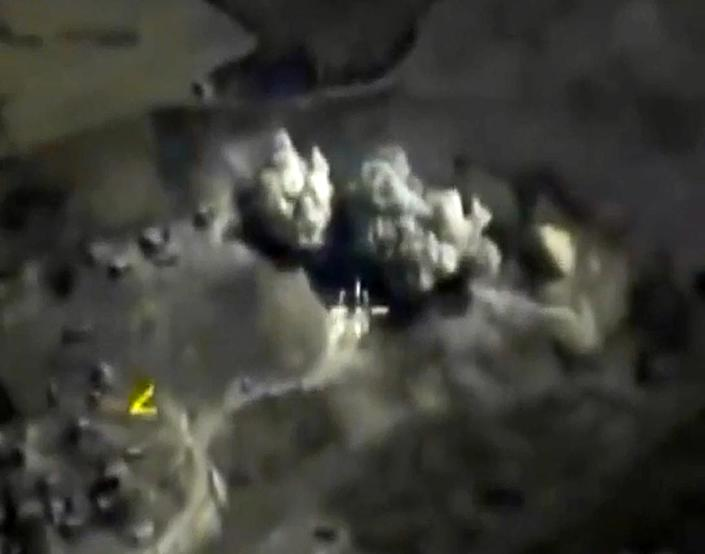 """Russian Defence Ministry footage purports to show airstrikes carried out by the Russian air force on an explosives warehouse in Raqqa last month"""" (AFP Photo/)"""