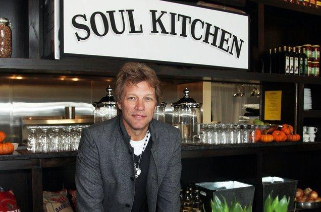 "<p>Rocker and New Jersey native Jon Bon Jovi opened two community dining restaurants named <a href=""https://www.jbjsoulkitchen.org/"" rel=""nofollow noopener"" target=""_blank"" data-ylk=""slk:JBJ Soul Kitchen"" class=""link rapid-noclick-resp"">JBJ Soul Kitchen</a> in his home state. Patrons can either donate the minimum for their meal or volunteer for an hour and eat for free. Diners of all backgrounds sit down together for a communal meal here in these restaurants dedicated to feeding those who can't afford a meal and building community. <br></p>"