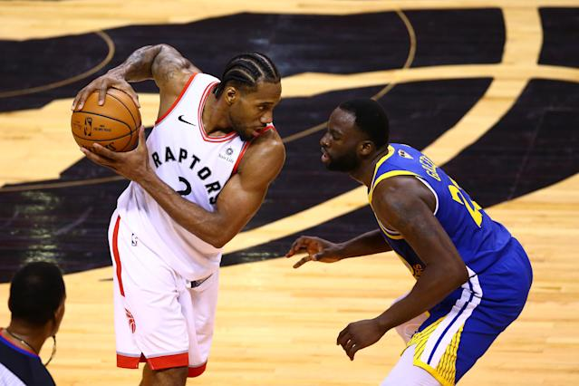 Kawhi Leonard #2 of the Toronto Raptors is defended by Draymond Green #23 of the Golden State Warriors in the second half during Game Five of the 2019 NBA Finals at Scotiabank Arena on June 10, 2019 in Toronto, Canada. (Photo by Vaughn Ridley/Getty Images)