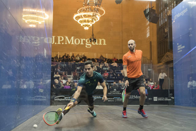 Cesar Salazar, left, of Mexico, returns a shot from Marwan El Shorbagy, of Egypt, during the JP Morgan Tournament of Champions professional squash competition at Grand Central Terminal in New York, Thursday, Jan. 18, 2018. (AP Photo/Mary Altaffer)