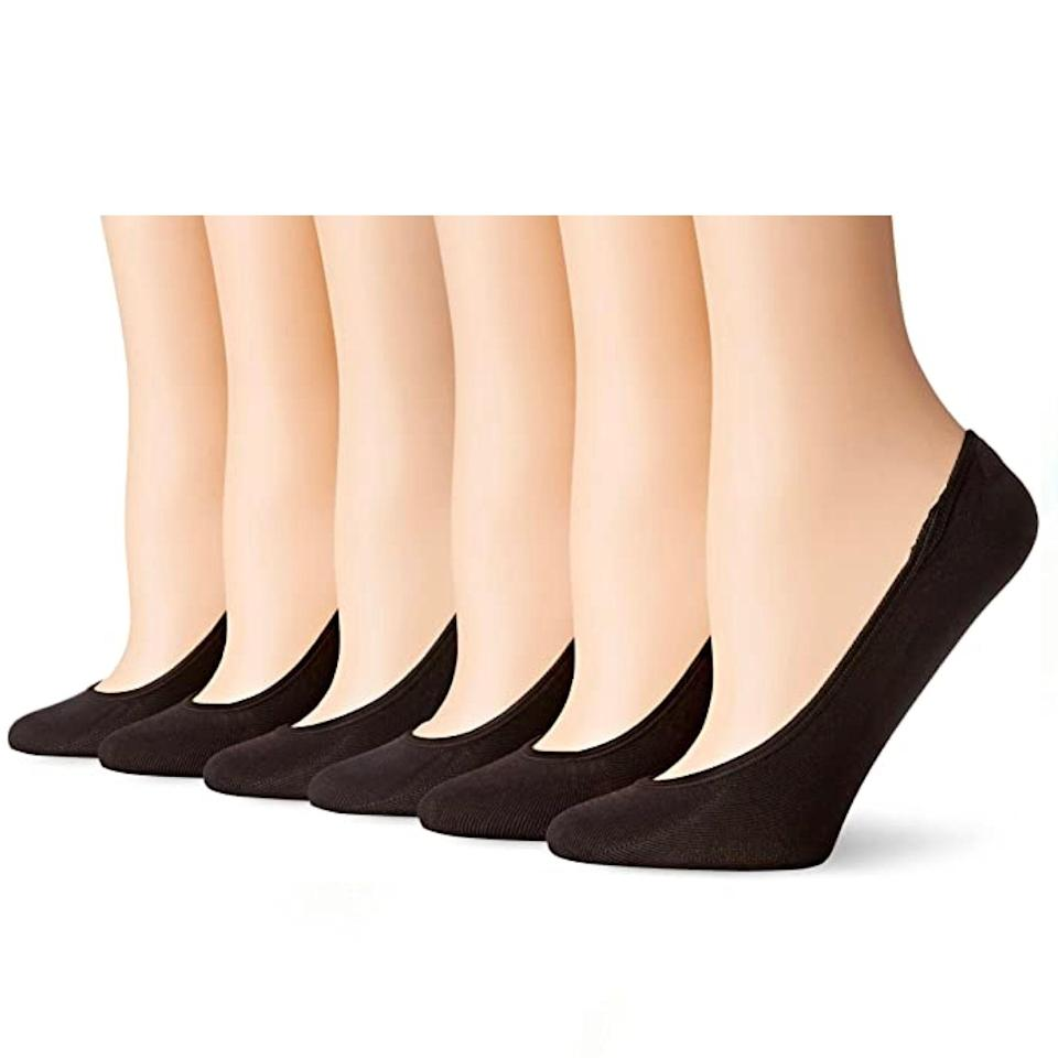 """Ballet flats, meet your new BFF. These gel-lined, low-cut liner socks play well with the slimmest of flats, while still hugging your foot in all the right places to ensure blister-free wear. $4, Amazon. <a href=""""https://www.amazon.com/PEDS-Womens-Ultra-Microfiber-Liner/dp/B00XMZ4IVM/ref="""" rel=""""nofollow noopener"""" target=""""_blank"""" data-ylk=""""slk:Get it now!"""" class=""""link rapid-noclick-resp"""">Get it now!</a>"""