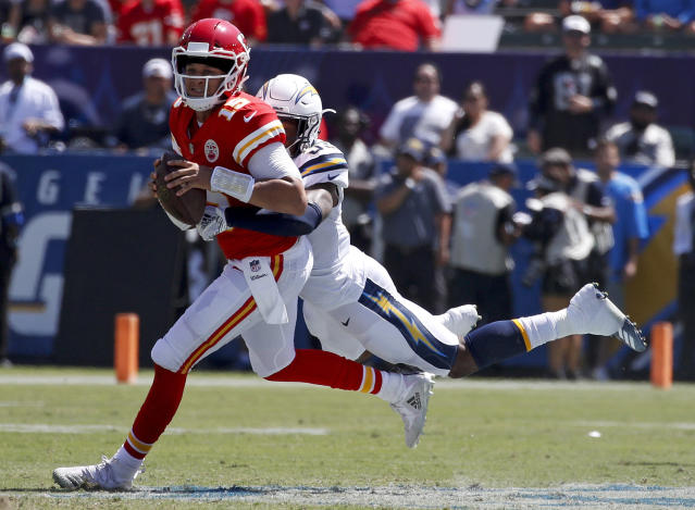 <p>Los Angeles Chargers defensive back Derwin James, right, tackles Kansas City Chiefs quarterback Patrick Mahomes during the first half of an NFL football game Sunday, Sept. 9, 2018, in Carson, Calif. (AP Photo/Kelvin Kuo) </p>