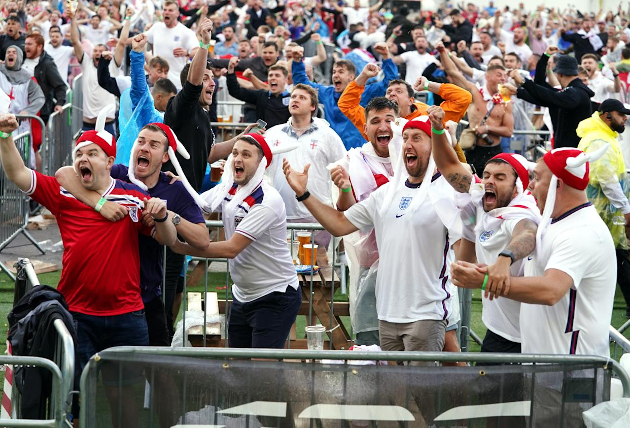 England fans in Manchester celebrate as Harry Kane scores his side's first goal, during the Euro2020 quarter final match between England and Ukraine. Picture date: Saturday July 3, 2021. (Photo by Martin Rickett/PA Images via Getty Images)