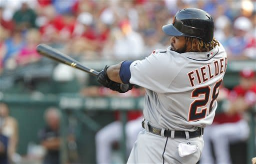 Detroit Tigers' Prince Fielder follows through on a two-run double against Texas Rangers pitcher Yu Darvish during the first inning of a baseball game Tuesday, June 26, 2012, in Arlington, Texas. (AP Photo/Tim Sharp)