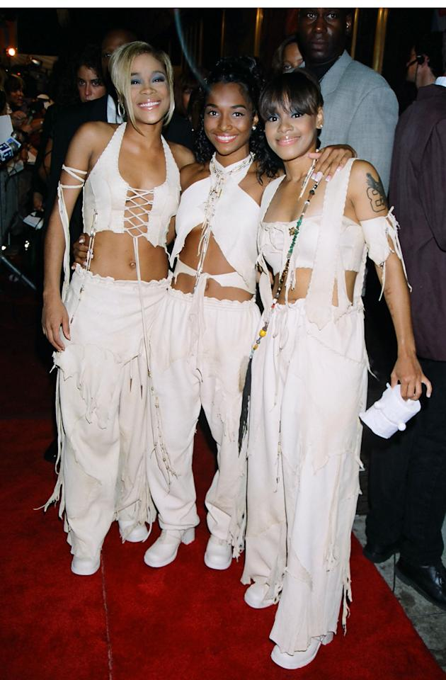 Baggy pants, bare midriffs, lace-up silhouettes — looks pretty modern doesn't it? TLC was one of the most powerful and stylish groups in the world and their influence is still felt strongly today.