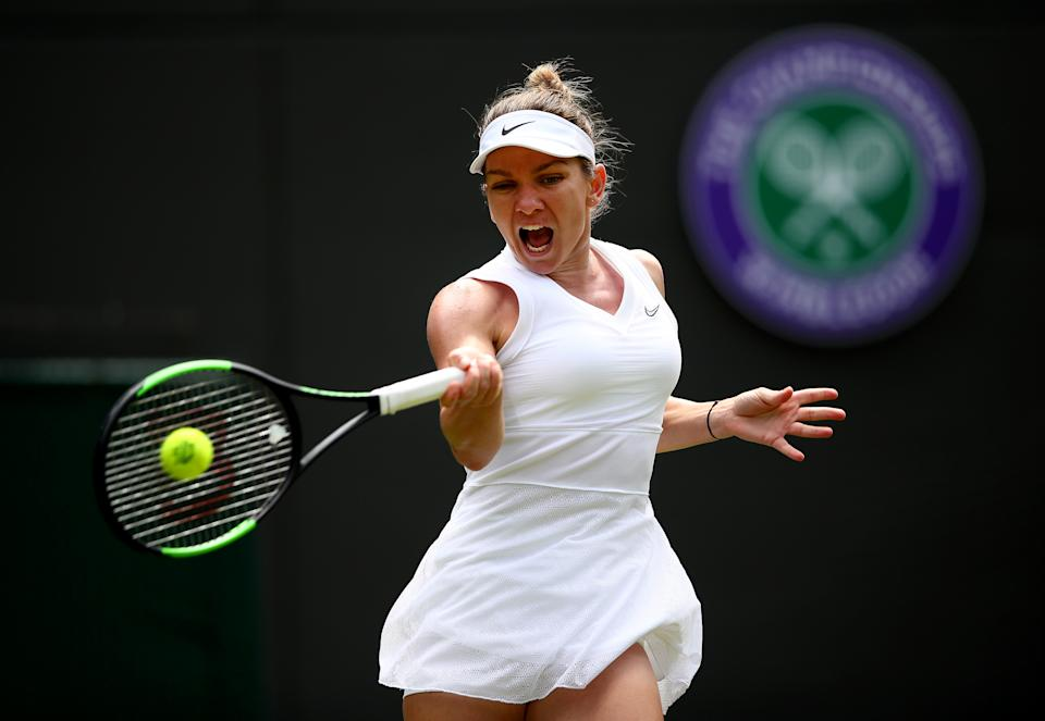 Simona Halep of Romania plays a forehand in her Ladies' Singles first round match against Aliaksandra Sasnovich of Belarus during Day one of The Championships - Wimbledon 2019 at All England Lawn Tennis and Croquet Club on July 01, 2019 in London, England. (Photo by Clive Brunskill/Getty Images)