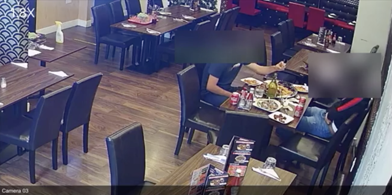 CCTV footage appears to show a man sprinkling something on his food.