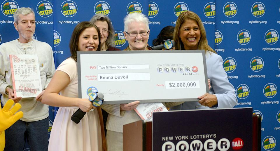 Emma Duvoll and her $2 million dollar lotto prize after playing numbers she found in a fortune cookie.