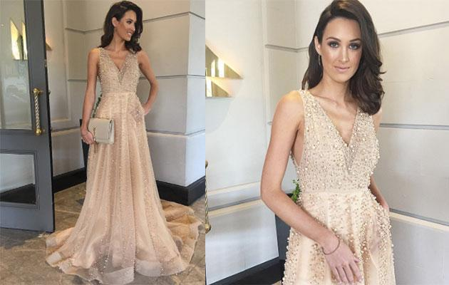 <p>The bronze beauty drips in rose gold glamour in a pearl and rose gold crystal embellished Jaimie Sortino gown and matching jewellery.</p>