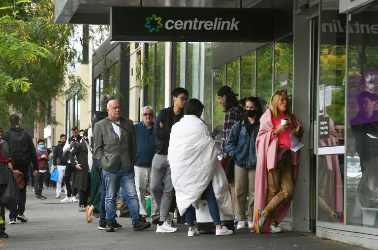Hundreds of people queue outside a government welfare centre, Centrelink, in Melbourne as jobless Australians flood unemployment offices