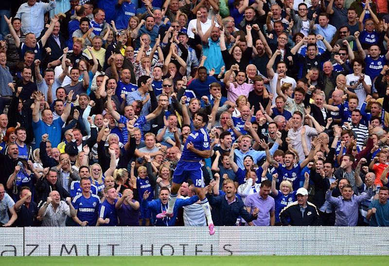 """Chelsea's Brazilian-born Spanish striker Diego Costa celebrates scoring the opening goal with teammates during the English Premier League football match between Chelsea and Leicester City at Stamford Bridge in London on August 23, 2014 RESTRICTED TO EDITORIAL USE. No use with unauthorized audio, video, data, fixture lists, club/league logos or """"live"""" services. Online in-match use limited to 45 images, no video emulation. No use in betting, games or single club/league/player publications. (AFP Photo/Carl Court)"""