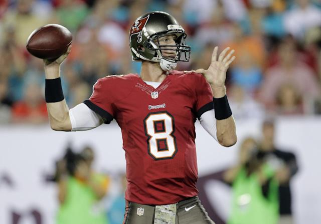 Tampa Bay Buccaneers quarterback Mike Glennon (8) throws a pass against the Miami Dolphins during the first quarter of an NFL football game Monday, Nov. 11, 2013, in Tampa, Fla. (AP Photo/Chris O'Meara)