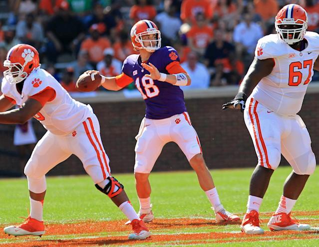 Clemson quarterback Cole Stoudt, center, throws a pass during the NCAA college football team's spring game at Memorial Stadium in Clemson, S.C., on Saturday, April 12, 2014. (AP Photo/Anderson Independent-Mail, Mark Crammer)